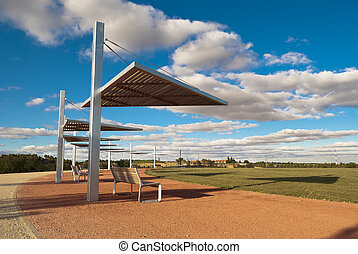 Row of park benchs with parasol - New park in Valladolid,...