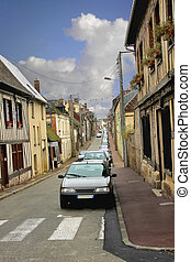 Row of parked cars on the street of Verneuil-sur-Avre. France