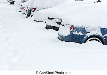 row of parked cars under snow