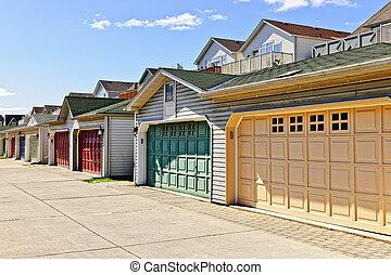 Row of parking garages - Row of garage doors at parking area...