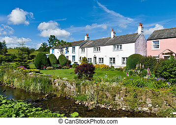 Row of picturesque cottages - a row of picturesque cottages ...