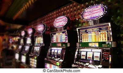 Row of play machines with blinking illumination in casino