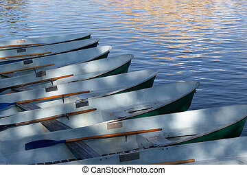 Row of pleasure or fishing boats at the pier on the pond