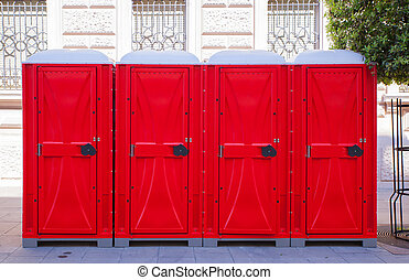 Row of portable toilets - View of row of red portable...