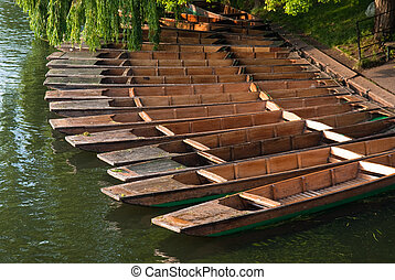 Row of punting boats on the Cam river in Cambridge, UK