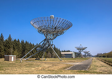 Long row of radio telescopes in westerbork in the Netherlands