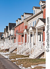 Row of Recently Built Townhouses on a Suburban Street