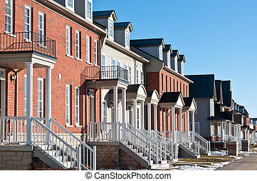 Row of Recently Built Townhouses on a Suburban Street - A...