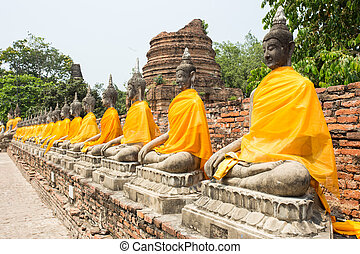Row of Sacred Buddhas at Wat Yaichaimongkol, Ayutthaya,...