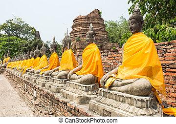 Row of Sacred Buddhas at Wat Yaichaimongkol, Ayutthaya, Thailand