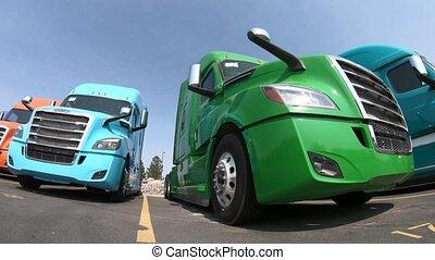 Row of Semi-Trucks at Dealership - Low Angle Clockwise...