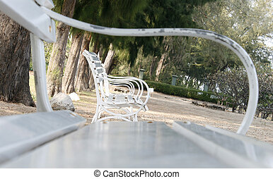 Row of several white benches