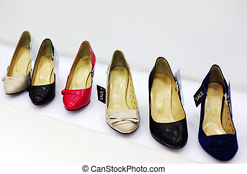 Row of six various women shoes in shop; new collection; attractive discounts