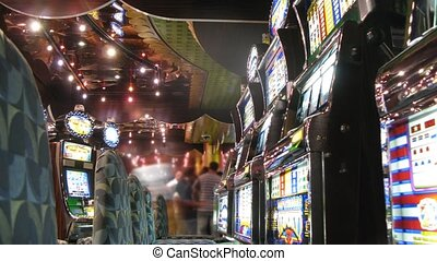 Row of slot machines with chairs in casino