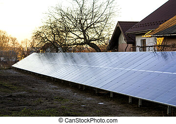 Row of solar electric panels for producing electricity