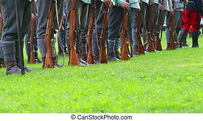 Row of soldiers with weapons - Soldiers with weapons in...