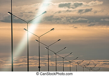 Row of streetlights at twilight - Row of streetlights at ...