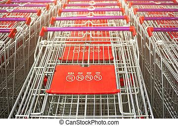 Row of supermarket shopping cart trolleys vintage look