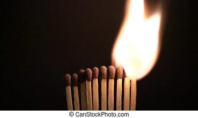 Row Of Ten Match Sticks Is Lit. - Row Of Ten Match Sticks Is...