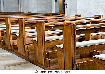row of vacant pews - row of vacant wooden church pews with...