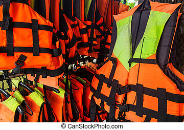 Row of Various Size Life Jacket for the Tourist