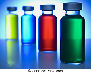 A row of vials filled with colored liquids. Focus on the green one.