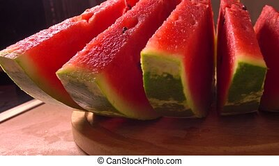 Row of watermelon slices closeup 4K pan shot