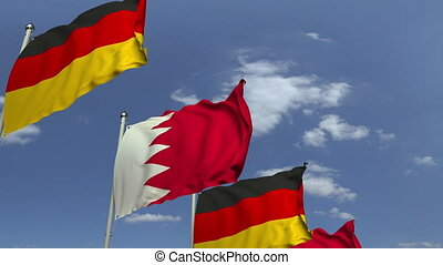 Row of waving flags of Bahrain and Germany, loopable 3D...