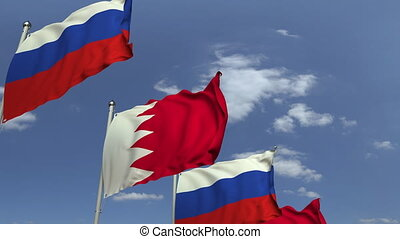 Row of waving flags of Bahrain and Russia, loopable 3D...