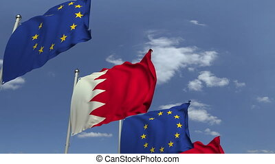 Row of waving flags of Bahrain and the European Union EU,...