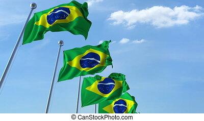 Row of waving flags of Brazil agaist blue sky, seamless loop
