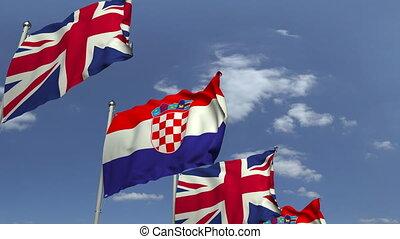 Row of waving flags of Croatia and the United Kingdom,...