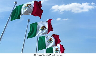Row of waving flags of Mexico agaist blue sky, seamless loop