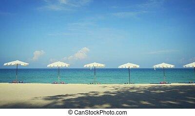Row of White Umbrellas on Tropical Surin Beach, Phuket,...
