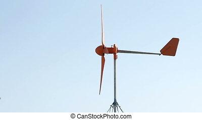 Row of wind power generator over blue sky