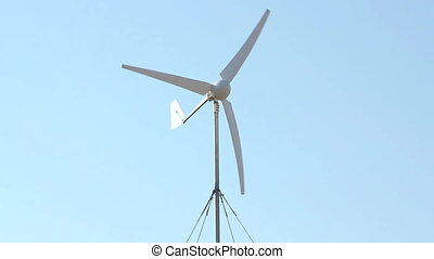 Row of wind power generator over sky