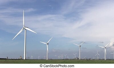 Row of wind turbines generating cl