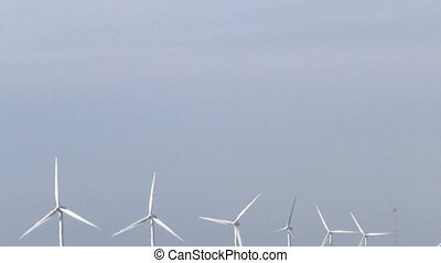 Row of  wind turbines generating