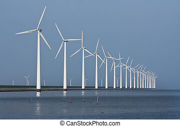 Row of windmills, mirrored in the Dutch sea - Long row of ...