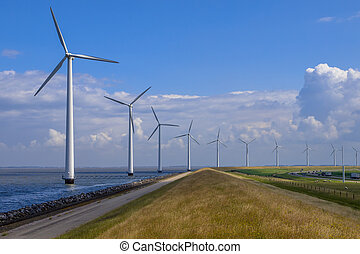 Row of windturbines along a dike - Row of windturbines the ...
