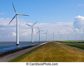 Row of windturbines along motorway