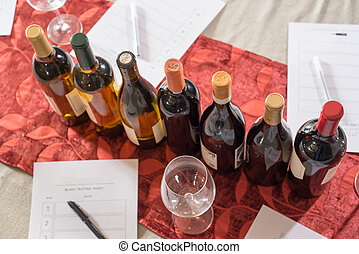 Row of Wine Bottles and Forms