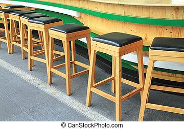 Row of wooden bar stools