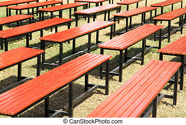 Row of wooden benches in the park