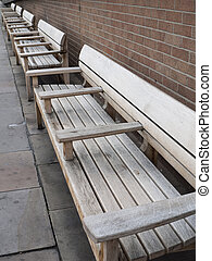 Row of wooden benches.