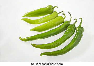 six peppers in a row on white background - sechs Paprika auf weissem Hintergrund