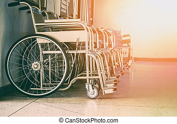 Row Wheelchairs in the hospital ,Wheelchairs waiting for patient services.