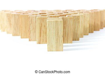 Row wooden domino against the white background
