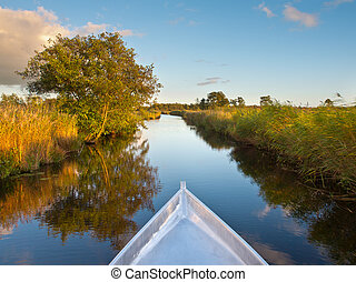 Row your Boat - Bow of a Rowing Boat in the Evening with...