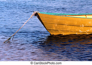 rowboat tied on sea in Iles de la Madeleine